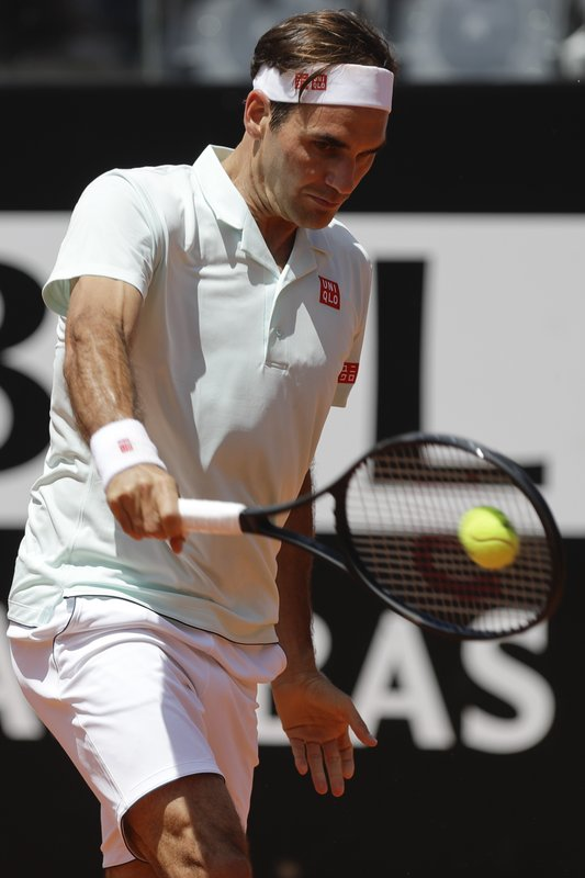 Switzerland's Roger Federer returns the ball during his match against Portugal's Joao Sousa at the Italian Open tennis tournament, in Rome, Thursday, May, 16, 2019. (AP Photo/Gregorio Borgia)