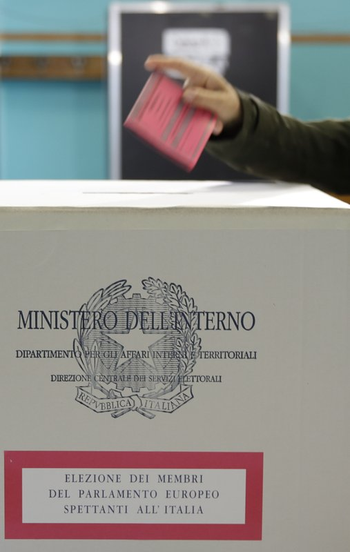 A voter casts the ballot at a polling station in Rome, Sunday, May 26, 2019. Pivotal elections for the European Union parliament reach their climax Sunday as the last 21 nations go to the polls and results are announced in a vote that boils down to a continent-wide battle between euroskeptic populists and proponents of closer EU unity. (AP Photo/Alessandra Tarantino)