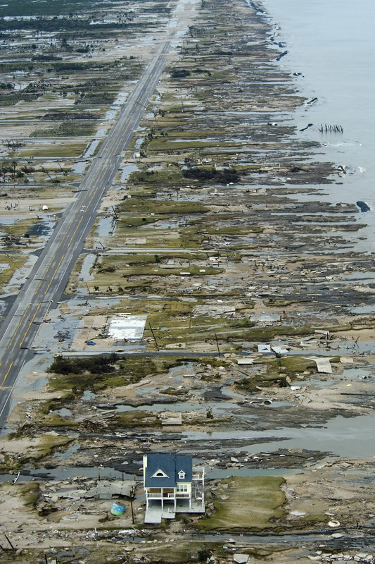 In this Sunday, Sept. 14, 2008 photo, a single house is left standing amidst the devastation left by Hurricane Ike, in Gilchrist, Texas. ( Smiley N. Pool/Houston Chronicle via AP)