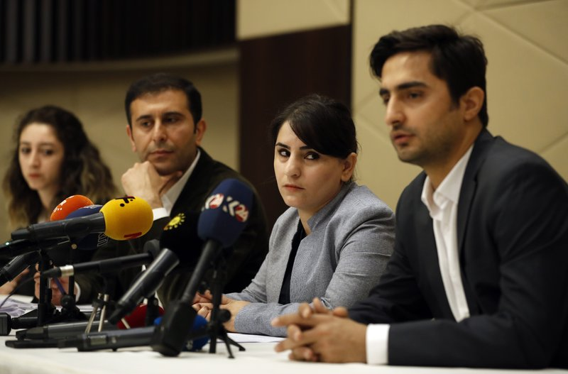 Nevroz Uysal, centre, one of the lawyers of imprisoned Kurdish rebel leader Abdullah Ocalan, looks on to Rezan Sarica, right, during a joint news conference wth other members of his legal team, in Istanbul, Sunday, May 26, 2019.In a letter released by his lawyers, Ocalan, who was allowed regular visits by his lawyers to his island prison only earlier this month, called for an end to hunger strikes and death fasts in protest to improve his prison conditions. (AP Photo/Lefteris Pitarakis)