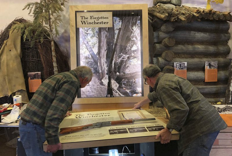 In this April 2019 photo workers for the design company DiVittorio and Associations help install the new exhibit at the visitor center at Great Basin National Park in Baker, Nev. for the