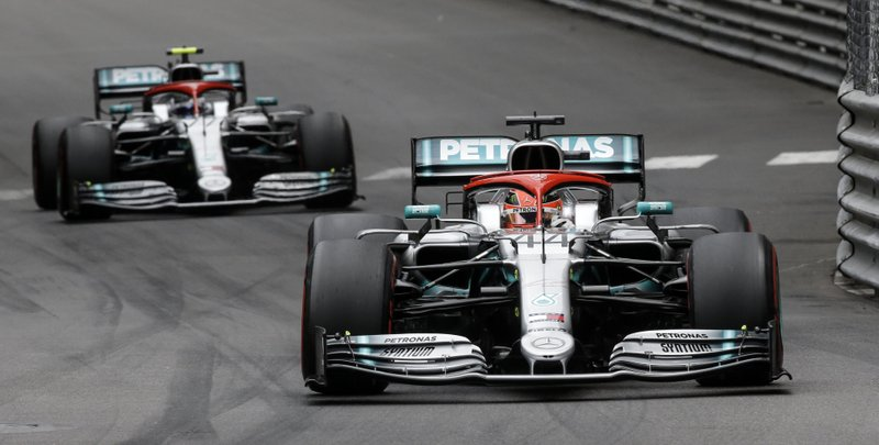 Mercedes driver Lewis Hamilton of Britain, right, steers his car in front of Mercedes driver Valtteri Bottas of Finland, left, during the Monaco Formula One Grand Prix race, at the Monaco racetrack, in Monaco, Sunday, May 26, 2019. (AP Photo/Luca Bruno)