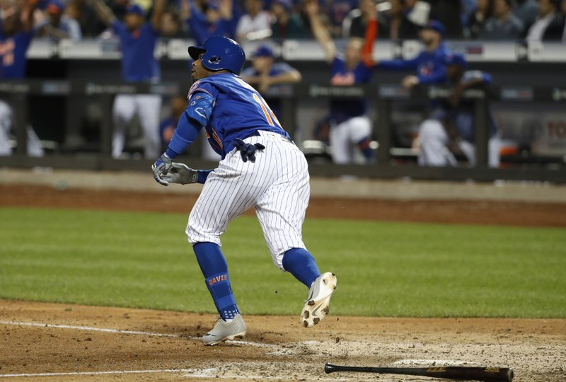 New York Mets Rajai Davis watches his eighth-inning, three-run home run in a baseball game against the Washington Nationals, Wednesday, May 22, 2019, in New York. (AP Photo/Kathy Willens)