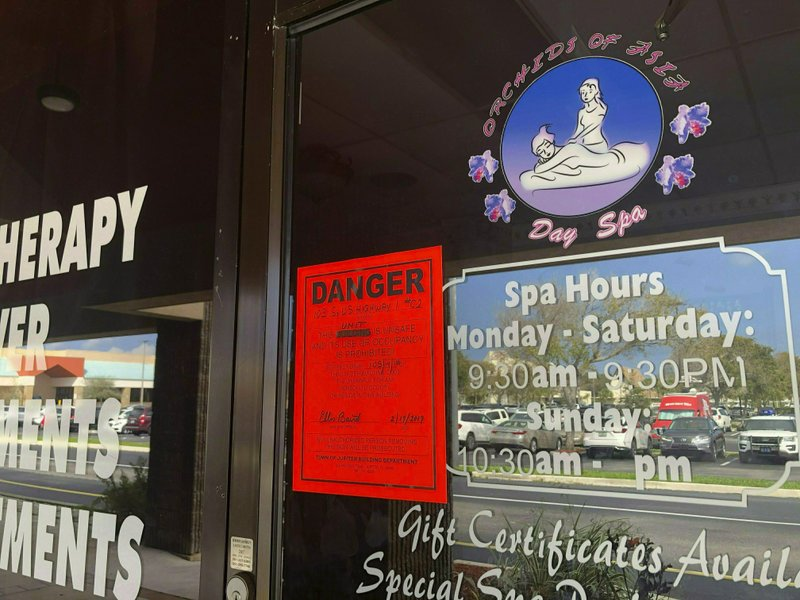 FILE - In this Feb. 19, 2019, file photo, a sign is posted outside of Orchids of Asia Day Spa in Jupiter, Fla., one of several spas closed in south Florida as a result of a six-month investigation into sex trafficking. An Associated Press review found at least 2,700 defendants have been charged with human trafficking at the state level across the U.S., but only about 1,000 were convicted of any crime since states started enacting the laws in 2003. Nearly 300 cases resulted in no conviction and hundreds of other cases remain pending. (Hannah Morse/Palm Beach Post via AP, File)