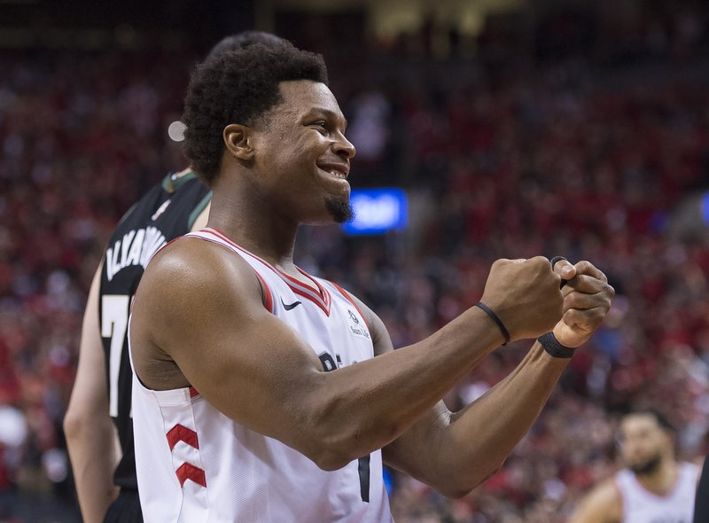 Toronto Raptors guard Kyle Lowry reacts in the finals seconds of Game 6 of the team's NBA basketball playoffs Eastern Conference finals against the Milwaukee Bucks on Saturday, May 25, 2019, in Toronto. The Raptors won 100-94 and advanced to the NBA Finals. (Nathan Denette/The Canadian Press via AP)