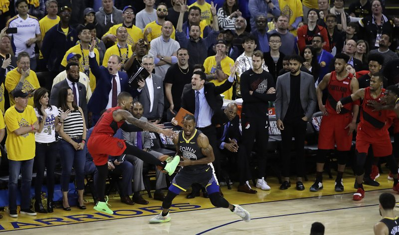 Golden State Warriors' Andre Iguodala, center, strips the ball from Portland Trail Blazers' Damian Lillard during the final seconds of Game 2 of the NBA basketball playoffs Western Conference finals Thursday, May 16, 2019, in Oakland, Calif. (AP Photo/Ben Margot)