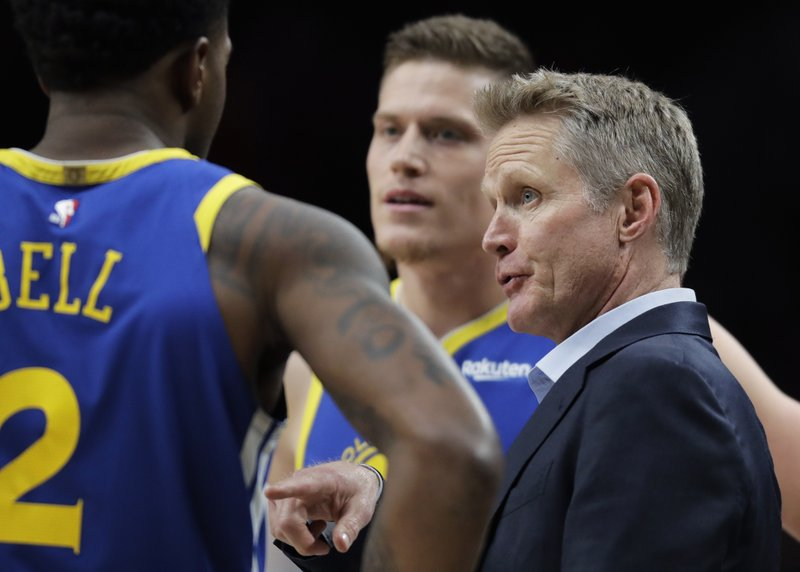 Golden State Warriors head coach Steve Kerr, right, talks to his team during a timeout in the first half of Game 3 of the NBA basketball playoffs Western Conference finals against the Portland Trail Blazers, Saturday, May 18, 2019, in Portland, Ore. (AP Photo/Ted S. Warren)