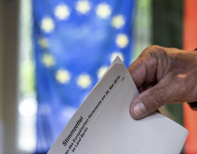A ballot for the European elections is casted in a polling station in Berlin, Germany, Sunday, May 26, 2019. (Michael Kappeler/dpa +++ dpa-Bildfunk +++/dpa via AP)