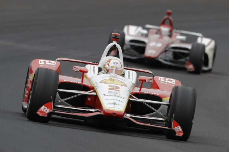 Josef Newgarden leads Ed Jones, of United Arab Emirates, through the first turn during the Indianapolis 500 IndyCar auto race at Indianapolis Motor Speedway, Sunday, May 26, 2019, in Indianapolis. (AP Photo/Darron Cummings)