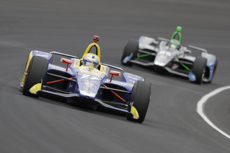 Alexander Rossi leads Conor Daly through the first turn during the Indianapolis 500 IndyCar auto race at Indianapolis Motor Speedway, Sunday, May 26, 2019, in Indianapolis. (AP Photo/Darron Cummings)