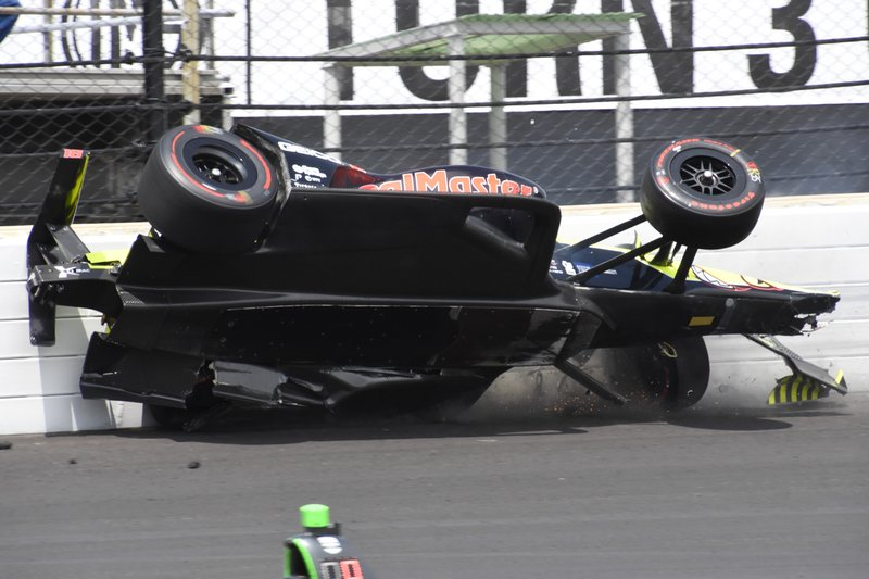 The car driven by Sebastien Bourdais, of France, hits the wall in the third turn during the Indianapolis 500 IndyCar auto race at Indianapolis Motor Speedway, Sunday, May 26, 2019, in Indianapolis. (AP Photo/Scott Anderson)