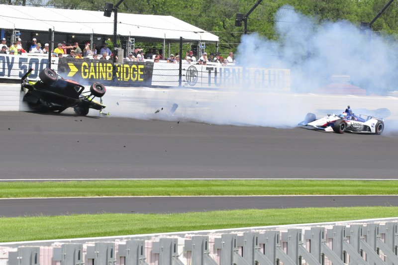 Sebastien Bourdais, of France, hits the wall in the third turn after making contact with Graham Rahal, right, during the Indianapolis 500 IndyCar auto race at Indianapolis Motor Speedway, Sunday, May 26, 2019, in Indianapolis. (AP Photo/James Miller)