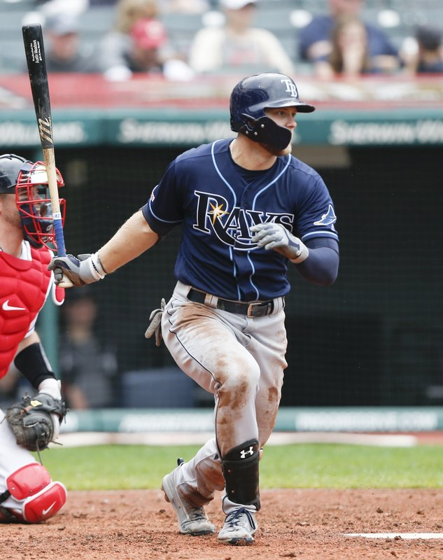 Tampa Bay Rays' Austin Meadows hits an RBI single off Cleveland Indians relief pitcher Nick Wittgren during the seventh inning of a baseball game, Sunday, May 26, 2019, in Cleveland. (AP Photo/Ron Schwane)