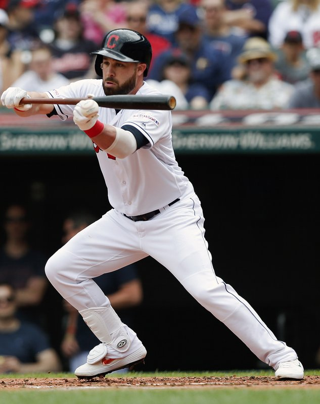 Cleveland Indians' Jason Kipnis bunts for a base hit off Tampa Bay Rays starting pitcher Ryne Stanek during the first inning of a baseball game, Sunday, May 26, 2019, in Cleveland. (AP Photo/Ron Schwane)