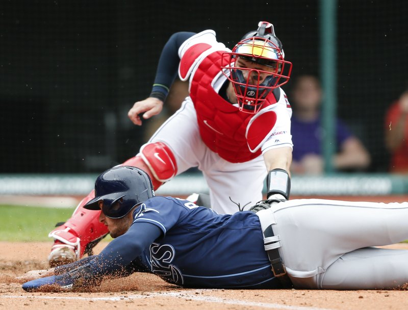 Tampa Bay Rays' Daniel Robertson scores past Cleveland Indians' Kevin Plawecki on a single by Tommy Pham during the third inning of a baseball game, Sunday, May 26, 2019, in Cleveland. (AP Photo/Ron Schwane)