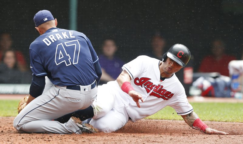Tampa Bay Rays relief pitcher Oliver Drake (47) tags out Cleveland Indians' Leonys Martin, right, at home plate during the seventh inning of a baseball game, Sunday, May 26, 2019, in Cleveland. (AP Photo/Ron Schwane)