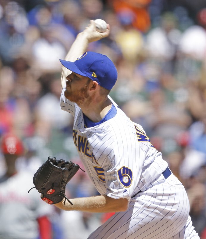 Milwaukee Brewers starting pitcher Brandon Woodruff throws to the Philadelphia Phillies during the first inning of a baseball game Sunday, May 26, 2019, in Milwaukee. (AP Photo/Jeffrey Phelps)
