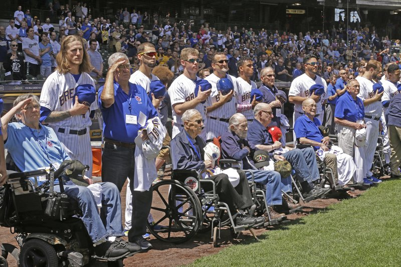 Members of the Milwaukee Brewers stand with veterans before a baseball game against the Philadelphia Phillies, Sunday, May 26, 2019, in Milwaukee. (AP Photo/Jeffrey Phelps)