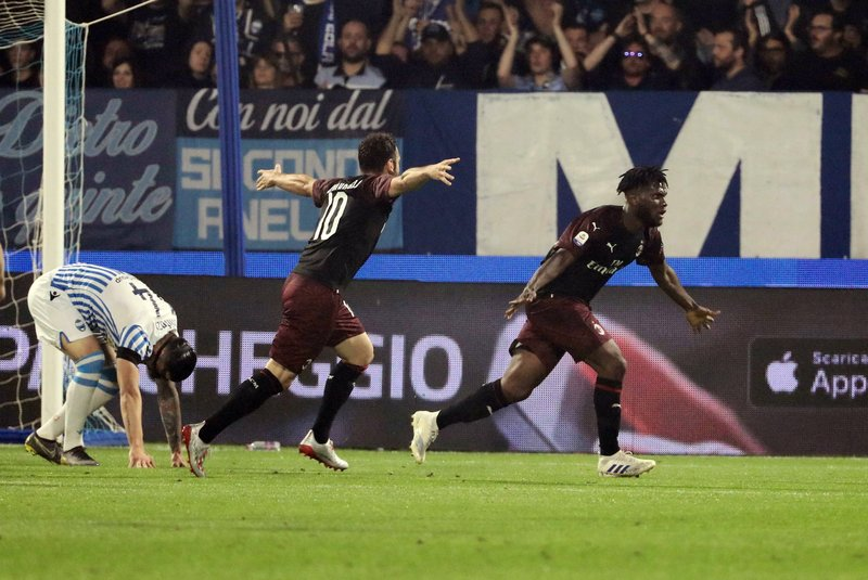 AC Milan's Franck Kessie, right, celebrates after scoring during the Serie A soccer match between AC Milan and SPAL, at the Paolo Mazza Stadium in Ferrara, Italy, Sunday, May 26, 2019. (Serena Campanini/ANSA via AP)
