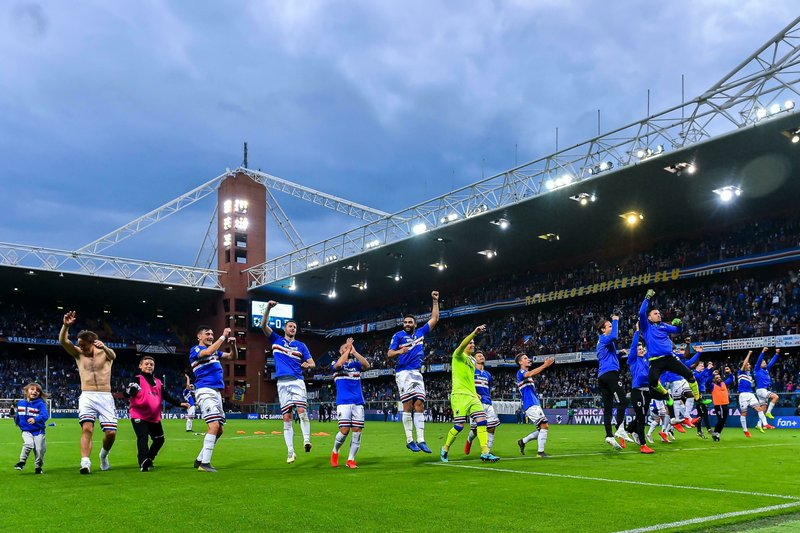 Sampdoria players celebrate with fans their 2-0 win at the end of the Serie A soccer match between Sampdoria and Juventus at Luigi Ferraris Stadium in Genoa, Italy, Sunday, May 26, 2019. (Simone Arveda/ANSA via AP)