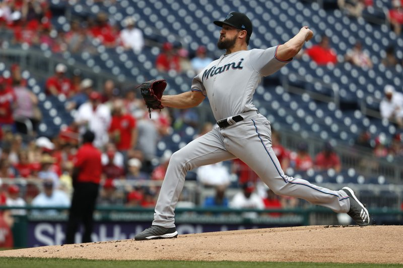 Miami Marlins starting pitcher Caleb Smith winds up against the Washington Nationals in the first inning of a baseball game, Sunday, May 26, 2019, in Washington. (AP Photo/Jacquelyn Martin)