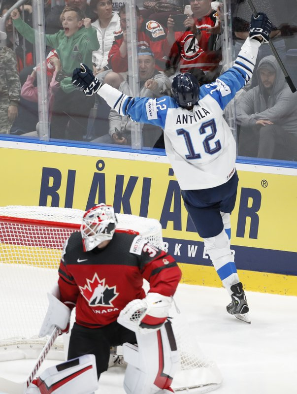 Finland's Marko Anttila (12) celebrates after scoring a goal past Canada goaltender Matt Murray (30) during the Ice Hockey World Championships gold medal match at the Ondrej Nepela Arena in Bratislava, Slovakia, Sunday, May 26, 2019. (AP Photo/Petr David Josek)