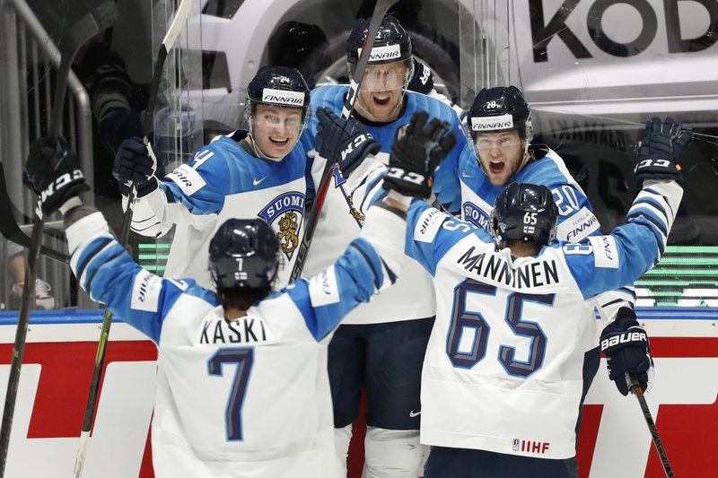 Finland's Marko Anttila, center, celebrates with Oliwer Kaski (7), Kaapo Kakko (24), Niko Ojamaki (20), and Sakari Manninen (65) after Anttila scored a goal against Canada during the Ice Hockey World Championships gold medal match at the Ondrej Nepela Arena in Bratislava, Slovakia, Sunday, May 26, 2019. (AP Photo/Petr David Josek)