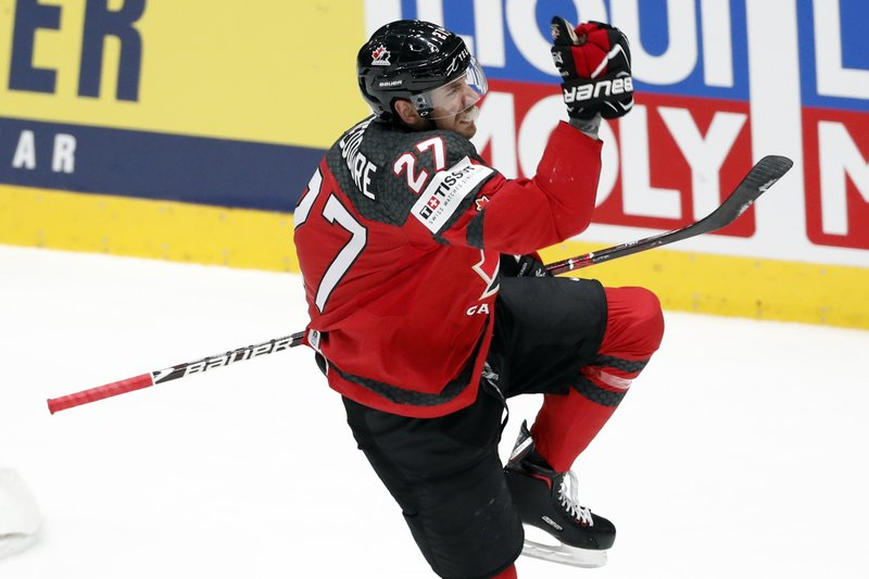 Canada's Shea Theodore (27) celebrates after scoring a goal against Finland during the Ice Hockey World Championships gold medal match at the Ondrej Nepela Arena in Bratislava, Slovakia, Sunday, May 26, 2019. (AP Photo/Petr David Josek)
