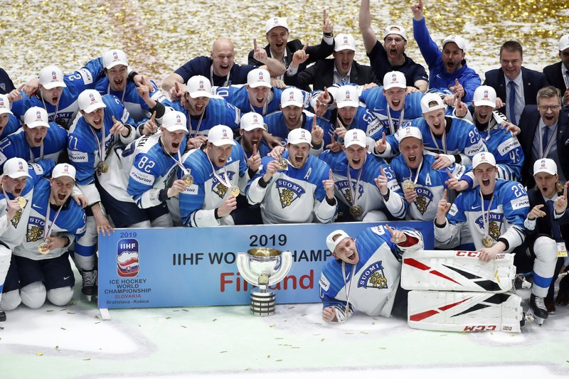 Finland players celebrate after beating Canada 3-1 in the Ice Hockey World Championships gold medal match at the Ondrej Nepela Arena in Bratislava, Slovakia, Sunday, May 26, 2019. (AP Photo/Petr David Josek)