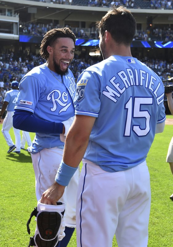Kansas City Royals' Billy Hamilton, left, and Whit Merrifield celebrate a 10th inning 8-7 win over the New York Yankees in a baseball game Sunday, May 26, 2019, in Kansas City, Mo. (AP Photo/Ed Zurga)