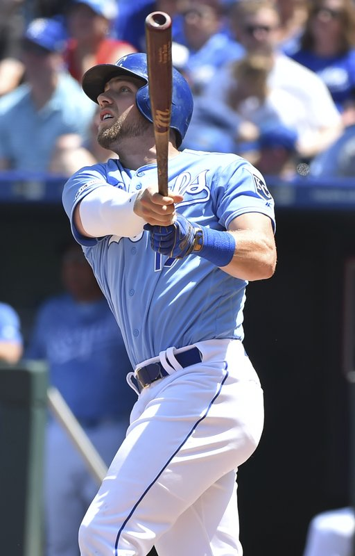 Kansas City Royals' Hunter Dozier watches his two-run home run in the fifth inning during a baseball game against the New York Yankees, Sunday, May 26, 2019, in Kansas City, Mo. (AP Photo/Ed Zurga)