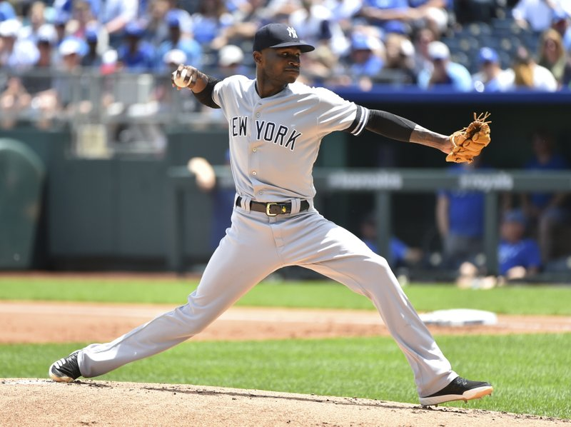 CORRECTS THE YEAR TO 2019, NOT 2018 AS ORIGINALLY SENT - New York Yankees starting pitcher Domingo German throws in the first inning against the Kansas City Royals during a baseball game Sunday, May 26, 2019, in Kansas City, Mo. (AP Photo/Ed Zurga)