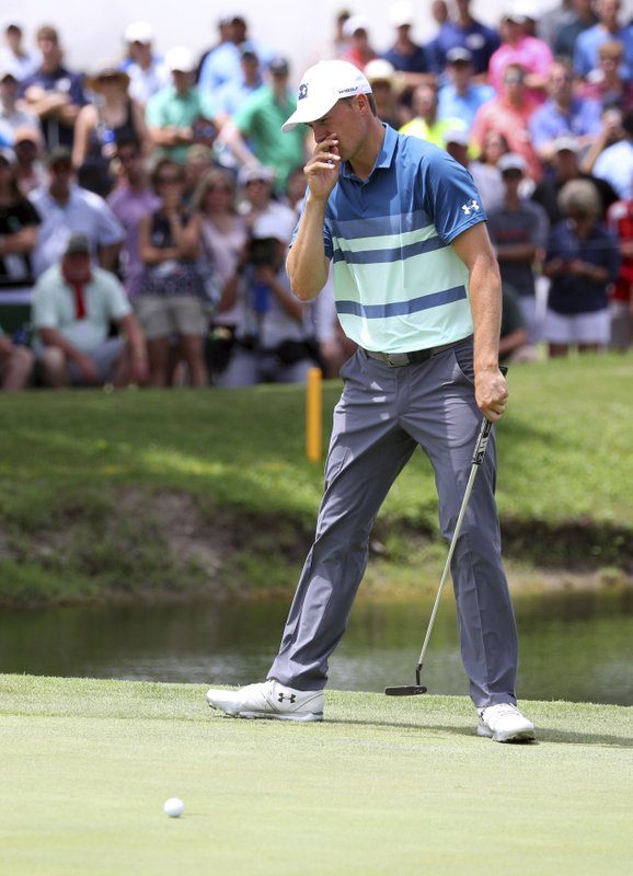 Jordan Spieth reacts after a missed putt on the ninth green in the final round of the Charles Schwab Challenge golf tournament Sunday, May 26, 2019 in Fort Worth, Texas. (AP Photo/ Richard W. Rodriguez)
