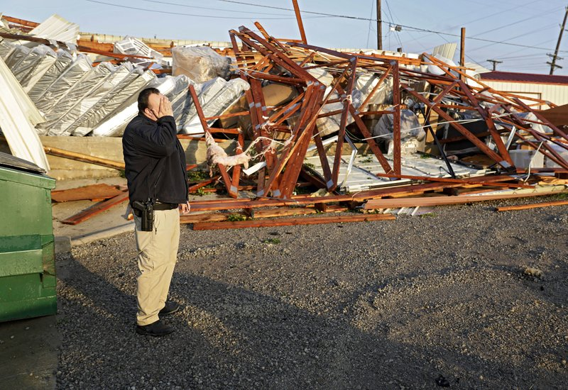 Justin Sloggett reacts while talking about his parents furniture store, The Saving Place Rustic Furniture and Mattress, after a suspected tornado destroyed their warehouse in Sapulpa, Okla. early Sunday, May 26, 2019. Sloggett was keeping an eye on the store at sunrise. (Mike Simons/Tulsa World via AP)
