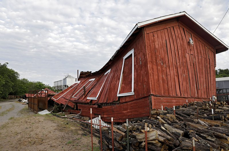 An historic railroad building owned by Farmers Feed Store was destroyed by a suspected tornado which hit Sapulpa, Okla. early Sunday, May 26, 2019. Farmers Feed Store uses the building, which has been there since at least the early 1900's, for storage. (Mike Simons/Tulsa World via AP)
