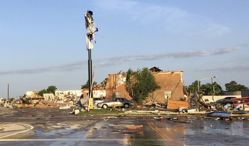 Debris lies on the ground at a motel after a deadly storm moved though the area in El Reno, Okla., Sunday, May 26, 2019. The storm destroyed the motel and roared through a nearby mobile home park and caused significant damage in the Oklahoma City area, officials said Sunday. (AP Photo/Tim Talley)