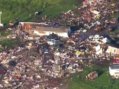 A tornado leveled a motel and tore through a mobile home park near Oklahoma City overnight, killing two people and injuring at least 29 others, authorities said Sunday. (May 26)