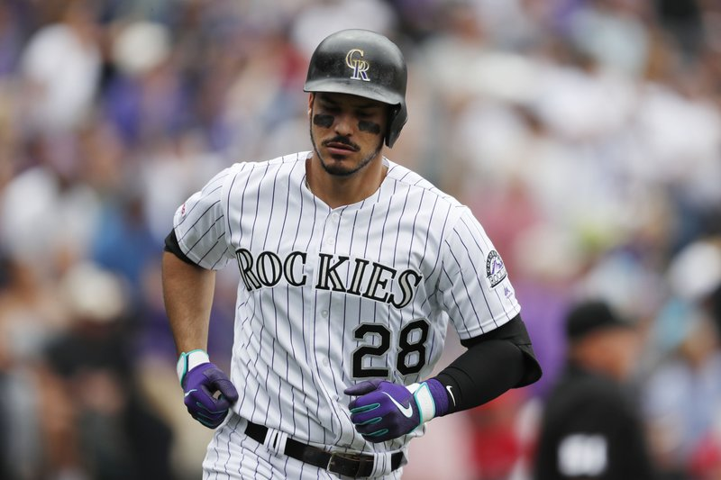 Colorado Rockies' Nolan Arenado heads up the first base line after hitting a two-run home run off Baltimore Orioles starting pitcher David Hess in the sixth inning of a baseball game Sunday, May 26, 2019, in Denver. (AP Photo/David Zalubowski)