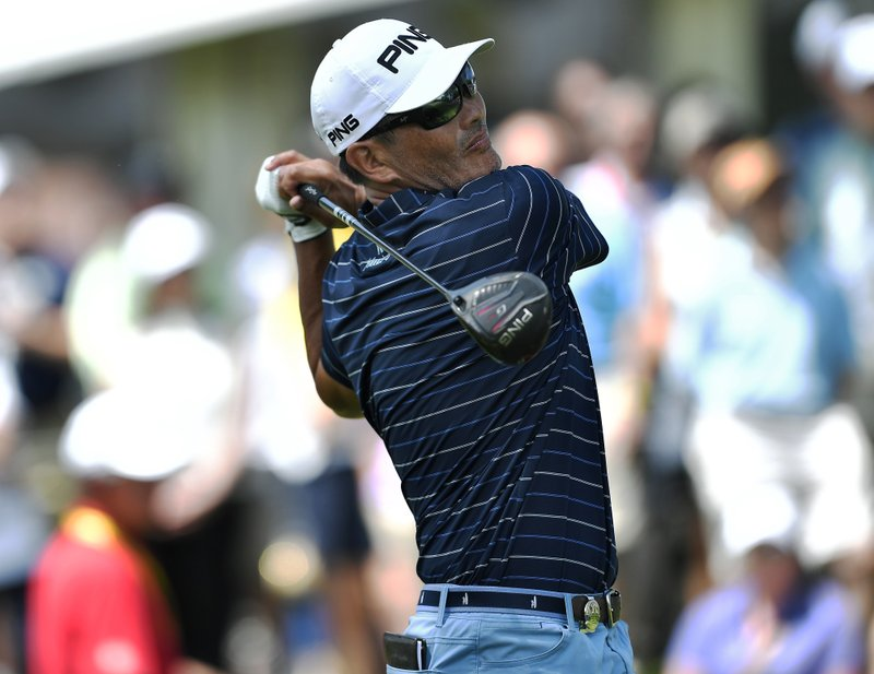 Ken Tanigawa watches his tee shot on the first hole during the final round of the Senior PGA Championship golf tournament, Sunday, May 26, 2019, in Rochester, N.Y. (AP Photo/Adrian Kraus)