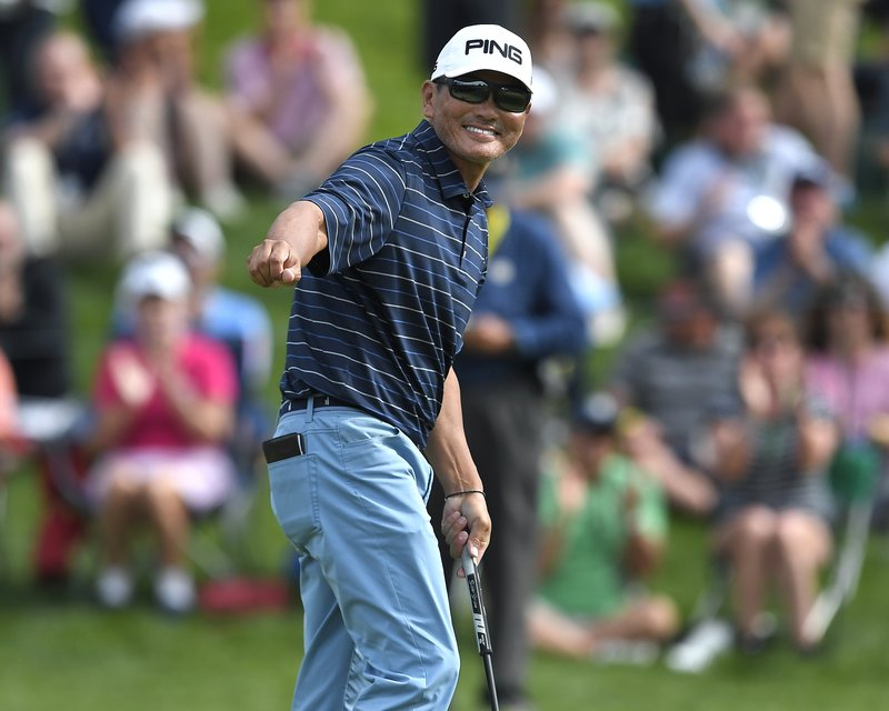 Ken Tanigawa reacts to his birdie putt on the 15th hole during the final round of the Senior PGA Championship golf tournament, Sunday, May 26, 2019, in Rochester, N.Y. Tanigawa won the championship. (AP Photo/Adrian Kraus)