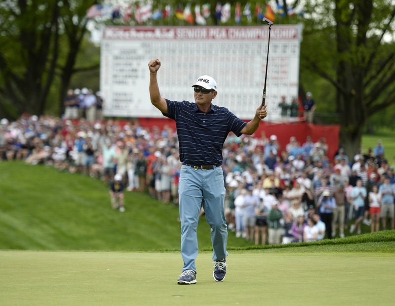 Ken Tanigawa reacts to his par putt on the 18th green during the final round of the Senior PGA Championship golf tournament, Sunday, May 26, 2019, in Rochester, N.Y. Tanigawa won the championship by one stroke over Scott McCarron. (AP Photo/Adrian Kraus)