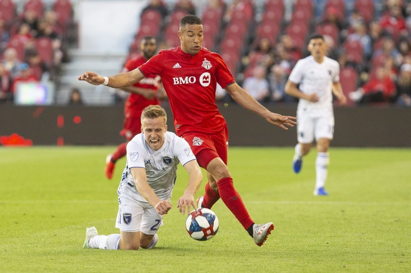 San Jose Earthquakes' Tommy Thompson, left, is fouled by Toronto FC's Justin Morrow during first half MLS soccer action in Toronto on Sunday, May 26, 2019. (Chris Young/The Canadian Press via AP)