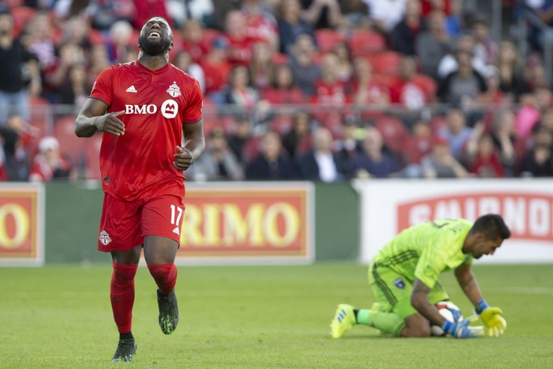 Toronto FC's Jozy Altidore (17) reacts after teammate Richie Laryea's shot went wide of the goal during first half MLS soccer action against the San Jose Earthquakes, in Toronto on Sunday, May 26, 2019. (Chris Young/The Canadian Press via AP)