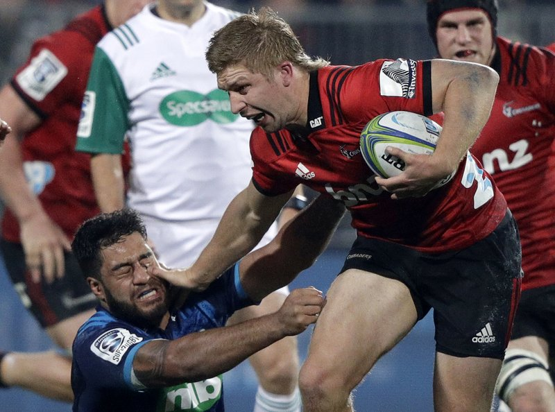 Crusaders Jack Goodhue, right, fends off Blues Akira Ioane during their Super Rugby match in Christchurch, New Zealand, Saturday, May 25, 2019. (AP Photo/Mark Baker)