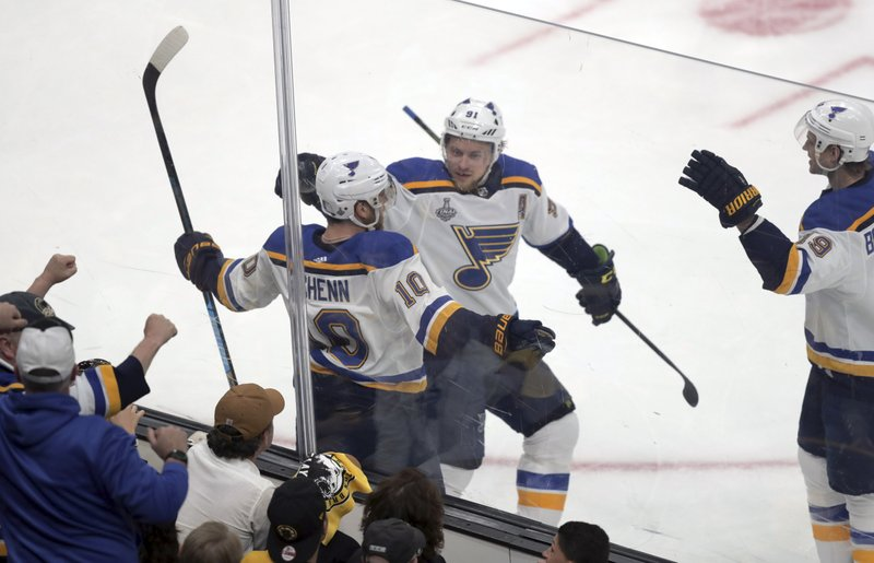 St. Louis Blues' Brayden Schenn, left, celebrates his goal with Vladimir Tarasenko, center, and Jay Bouwmeester, right, during the first period in Game 1 of the NHL hockey Stanley Cup Final against the Boston Bruins, Monday, May 27, 2019, in Boston. (AP Photo/Charles Krupa)