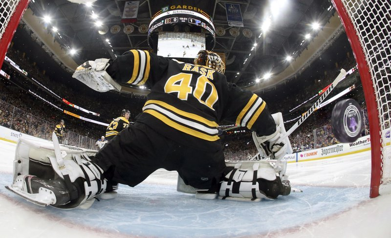 A puck shot by St. Louis Blues' Vladimir Tarasenko, of Russia, sails past Boston Bruins goaltender Tuukka Rask (40), of Finland, for a goal during the second period period in Game 1 of the NHL hockey Stanley Cup Final, Monday, May 27, 2019, in Boston. (Bruce Bennett/Pool via AP)
