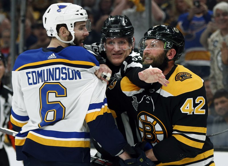 Linesman Greg Devorski separates St. Louis Blues' Joel Edmundson (6) and Boston Bruins' David Backes (42) during the second period in Game 1 of the NHL hockey Stanley Cup Final, Monday, May 27, 2019, in Boston. (AP Photo/Michael Dwyer)