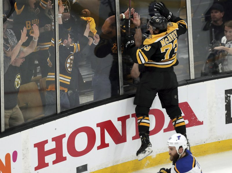 Boston Bruins' Charlie McAvoy jumps into the endboards to celebrate his goal against the St. Louis Blues during the second period in Game 1 of the NHL hockey Stanley Cup Final, Monday, May 27, 2019, in Boston. (AP Photo/Charles Krupa)