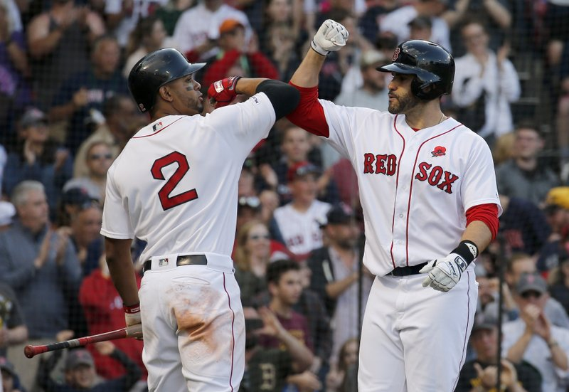 Boston Red Sox's J.D. Martinez, right, is congratulated by Xander Bogaerts after hitting a solo home run during the sixth inning of a baseball game against the Cleveland Indians, Monday, May 27, 2019, in Boston. (AP Photo/Mary Schwalm)