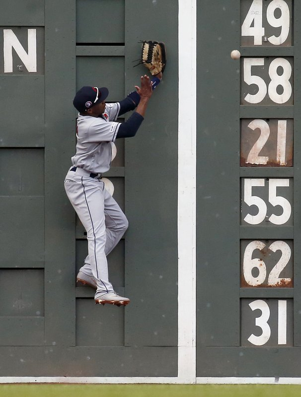 Cleveland Indians center fielder Greg Allen cannot make a catch against the wall on a double by Boston Red Sox's Jackie Bradley Jr. during the seventh inning of a baseball game, Monday, May 27, 2019, in Boston. (AP Photo/Mary Schwalm)